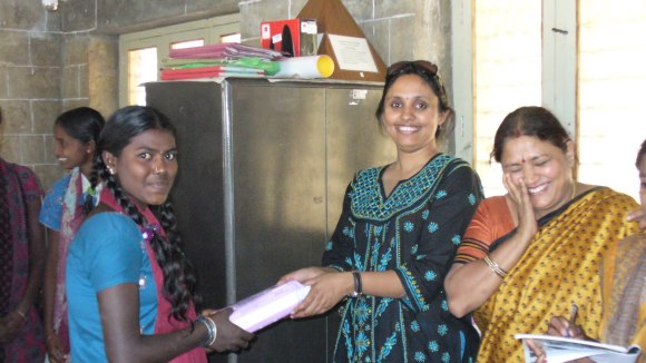 Vyjayanthi and Namita distributing sanitary napkins procured from Mount Carmel (Year 2010)