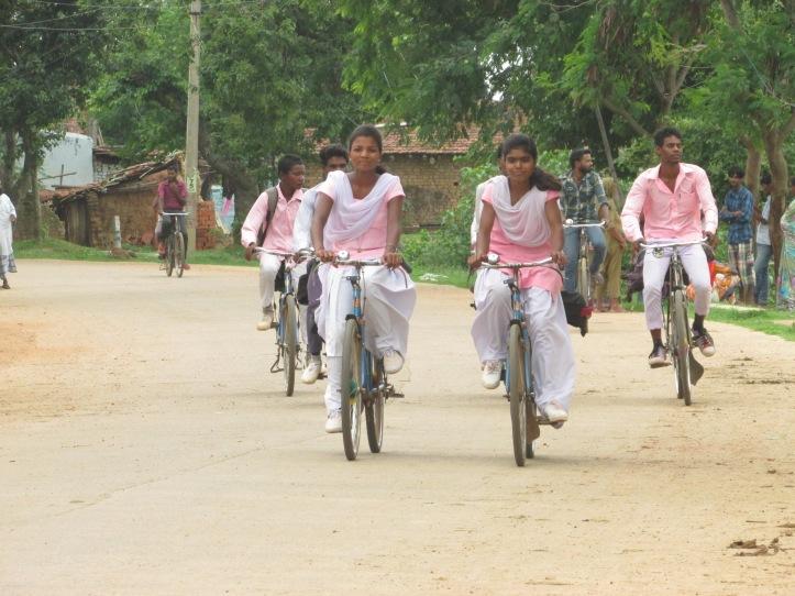 Girls cycling to school