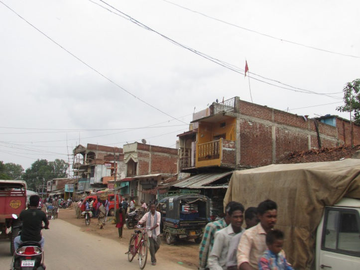 Unfinished buildings and houses in a busy area