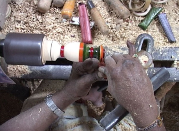 Kenchaiah deftly crafts a toy with his now cured right hand